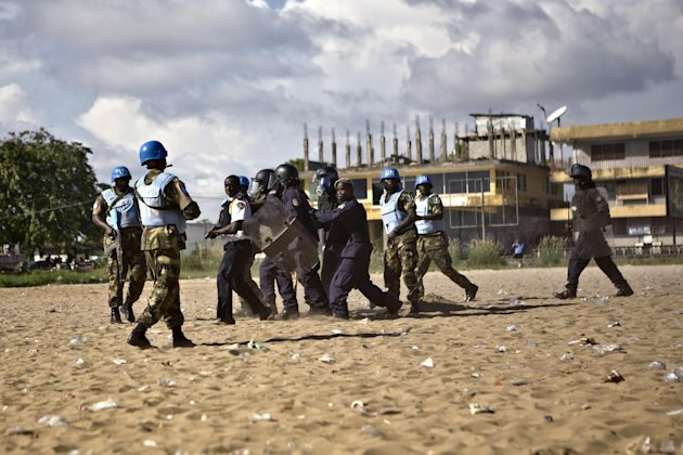 Liberian police officers and UN peacekeepers makes arrests during a riot in Monrovia in November 2011