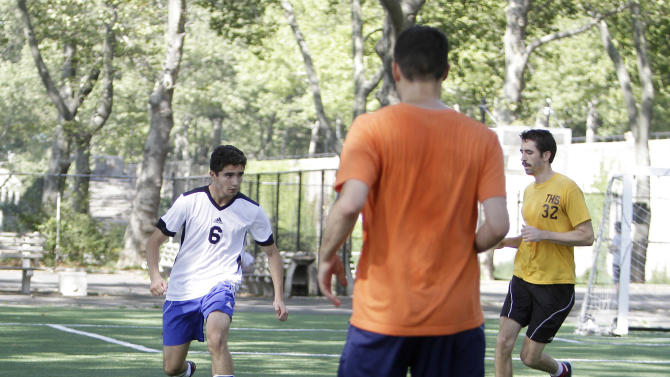 A team Angola player, left, prepares to challenge team  Holland's defense during the New York City World Cup on Aug. 4, 2012 at Harlem's Riverside Park in Manhattan. The New York tournament, with 20 teams representing countries worldwide, gives more than 200 soccer enthusiasts a chance to play with an international scope without leaving the city. Holland has moved on to the quarter-finals along with Italy, Argentina, USA, France, Chile, Portugal and Ivory Coast.  (AP Photo/Fay Abuelgasim)