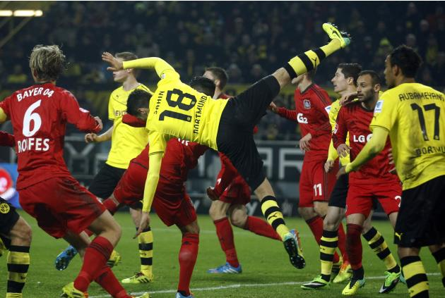 Borussia Dortmund's Nuri Sahin falls after heading a ball during their German first division Bundesliga soccer match against Bayer Leverkusen in Dortmund