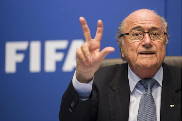 FIFA President Sepp Blatter gestures as he speaks to journalists following the FIFA Executive Committee meeting in Zurich, Switzerland, Friday, Oct. 4, 2013. Blatter said a final decision on which mon