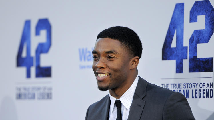 "Chadwick Boseman, who plays baseball legend Jackie Robinson in ""42,"" poses at the Los Angeles premiere of the film at the TCL Chinese Theater on Tuesday, April 9, 2013 in Los Angeles. (Photo by Chris Pizzello/Invision/AP)"