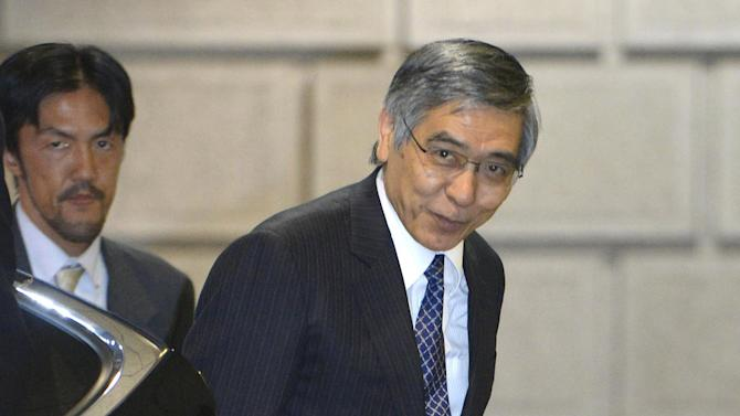 Newly appointed Bank of Japan Gov. Haruhiko Kuroda bows to the media upon his arrival at the central bank head office in Tokyo for the first time as its chief Thursday afternoon, March 21, 2013. Kuroda, a finance ministry veteran and former president of the Asian Development Bank, reaffirmed his pledge to prioritize getting Japan's economy out of its long bout of deflation. (AP Photo/Kyodo News) JAPAN OUT, MANDATORY CREDIT, NO LICENSING IN CHINA, HONG KONG, JAPAN, SOUTH KOREA AND FRANCE