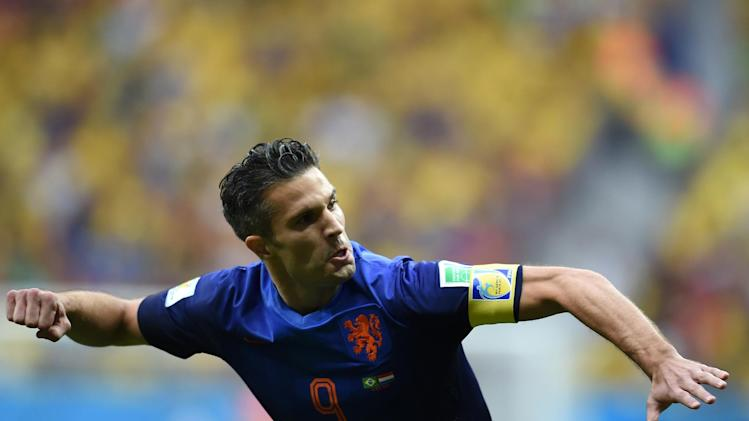 Netherlands' forward and captain Robin van Persie celebrates after scoring a goal during the third place play-off football match between Brazil and Netherlands at the National Stadium in Brasilia on July 12, 2014