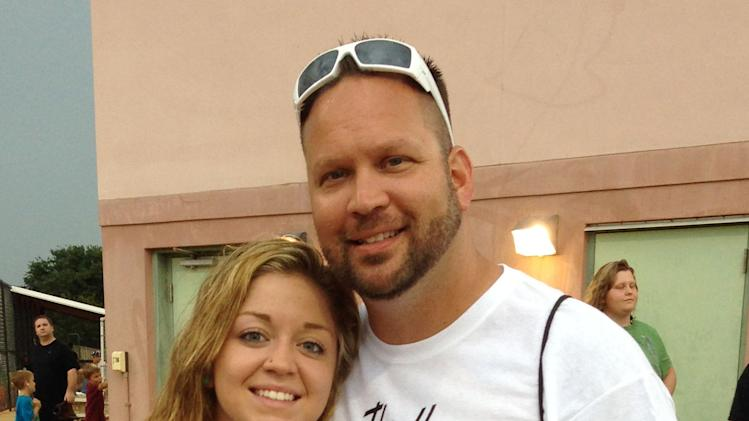 In this photo made available by the Hunt family,  Kaitlyn Hunt and her father Steve in Vero Beach, Fla., Monday May 20, 2013. Kaitlyn, 18, was expelled from school  for dating and having sex with her 14-year-old girlfriend, who was a fellow player on her basketball team. Hunt was arrested and charged with two felony counts of lewd and lascivious battery on a child 12 to 16 years. (AP Photo/Hunt Family, HO)
