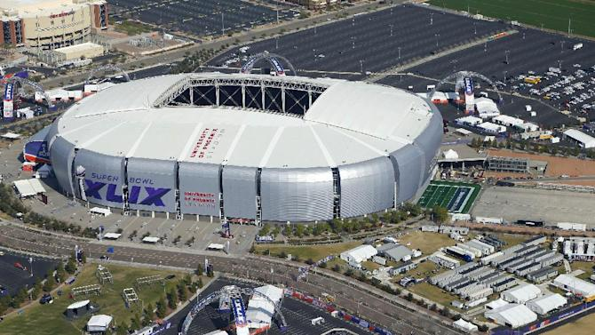 In this aerial photo, the playing field for the NFL Super Bowl XLIX football game is rolled into the University of Phoenix Stadium, Wednesday, Jan. 28, 2015, in Glendale, Ariz.  The Super Bowl game between the New England Patriots and the Seattle Seahawks will be played this Sunday