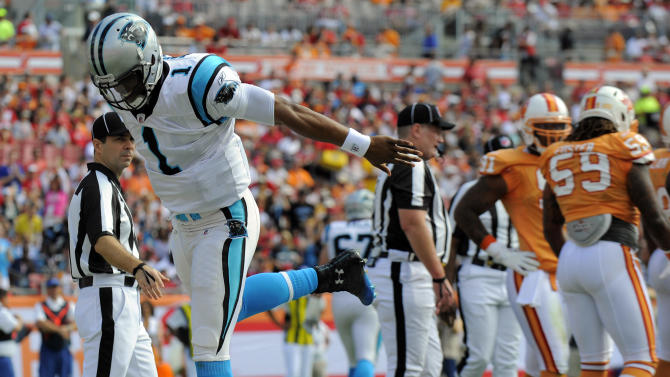 Carolina Panthers quarterback Cam Newton (1) reacts after scoring on a one-yard run during the first quarter of an NFL football game against the Tampa Bay Buccaneers, Sunday, Dec. 4, 2011, in Tampa, Fla. (AP Photo/Brian Blanco)