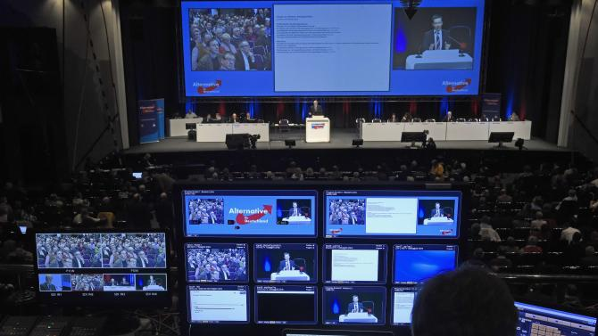 "A technician sits in front of monitors and screens showing the speech of Bernd Lucke, chairman of German anti-Euro party ""The Alternative fuer Deutschland"" (AfD)  during a party meeting in Bremen"