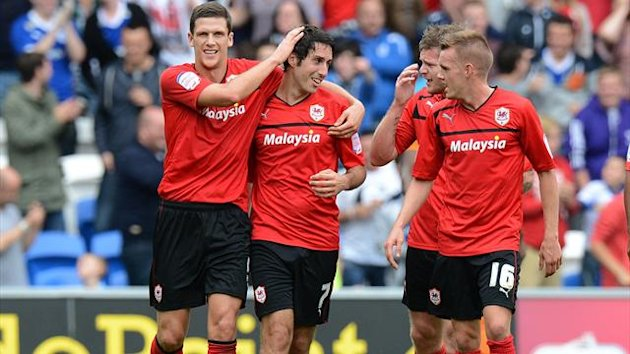 ardiff City's Mark Hudson congratulates Peter Whittingham on scoring his hat-trick and Cardiff City's third goal (PA Photos)