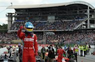 Fernando Alonso celebrates at Hockenheimring after winning the German Formula One Grand Prix. The 30-year-old Spaniard started from pole position and dominated the 67-lap race in consummate style as he came home 3.7 seconds ahead of local hero, defending champion Sebastian Vettel of Red Bull