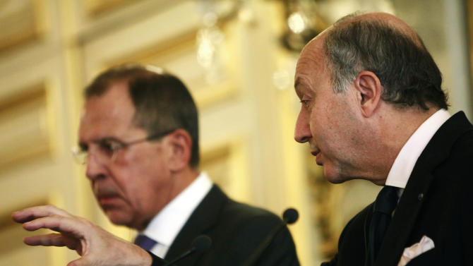 French foreign minister Laurent Fabius, right, speaks during a joint news conference with Russian foreign minister Sergei Lavrov at the French foreign ministry, in Paris, Wednesday, Oct. 31 2012. French and Russian ministers are engaged in bilateral cooperation talks. (AP Photo/Thibault Camus)