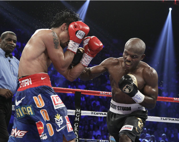 Timothy Bradley, from Palm Springs, Calif., goes on the offense against Manny Pacquiao, from the Philippines, in their WBO world welterweight title fight Saturday, June 9, 2012, in Las Vegas. Bradley