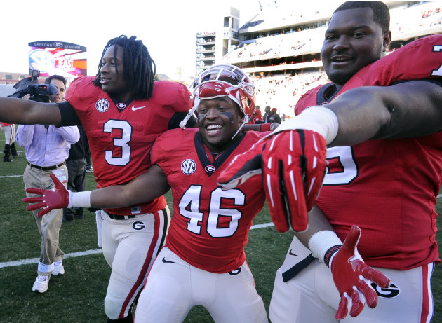 Georgia running back Todd Gurley (3), fullback Alexander Ogletree (46), and guard Mark Beard (79) celebrate their 42-10 win over Georgia Tech after an NCAA college football game, Saturday, Nov. 24, 20