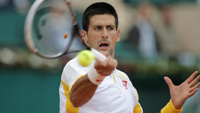 Novak Djokovic of Serbia plays a return to Jarkko Nieminen of Finland during their quarter final match of the Monte Carlo Tennis Masters tournament in Monaco, Friday, April 19, 2013. (AP Photo/Lionel Cironneau)