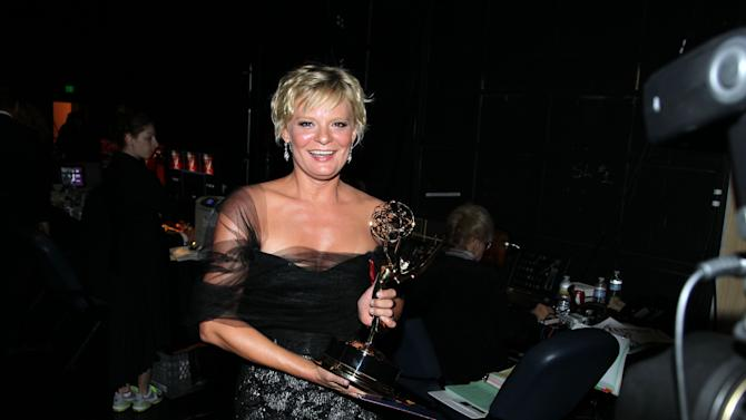 """Martha Plimpton poses backstage with her award for outstanding guest actress in a drama series for playing Patti Nyholm on """"The Good Wife"""" at the 2012 Creative Arts Emmys at the Nokia Theatre on Saturday, Sept. 15, 2012, in Los Angeles. (Photo by Matt Sayles/Invision/AP)"""