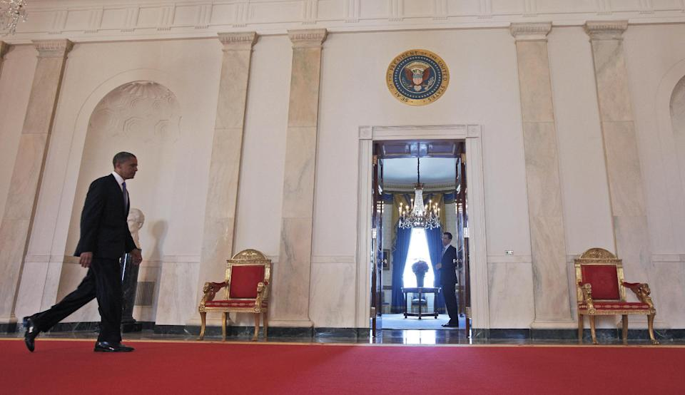 President Barack Obama walks back to the Blue Room of the White House in Washington, Thursday, June 28, 2012, after the Supreme Court ruled on his health care legislation. (AP Photo/Pablo Martinez Monsivais/pool)