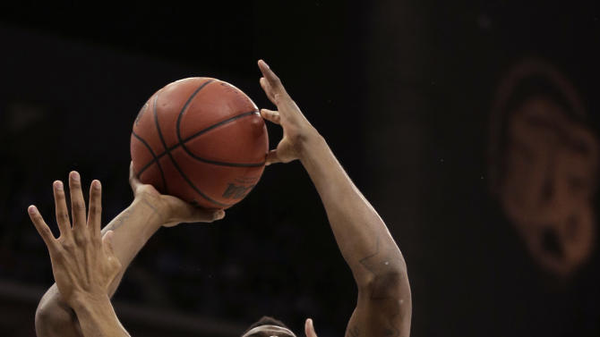 North Carolina guard/forward Reggie Bullock (35) shoots under pressure from Kansas forward Kevin Young (40) during the first half of a third-round game in the NCAA college basketball tournament Sunday March 24, 2013, in Kansas City, Mo. (AP Photo/Charlie Riedel)