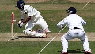 Mukund cops one in the visor from Tremlett.