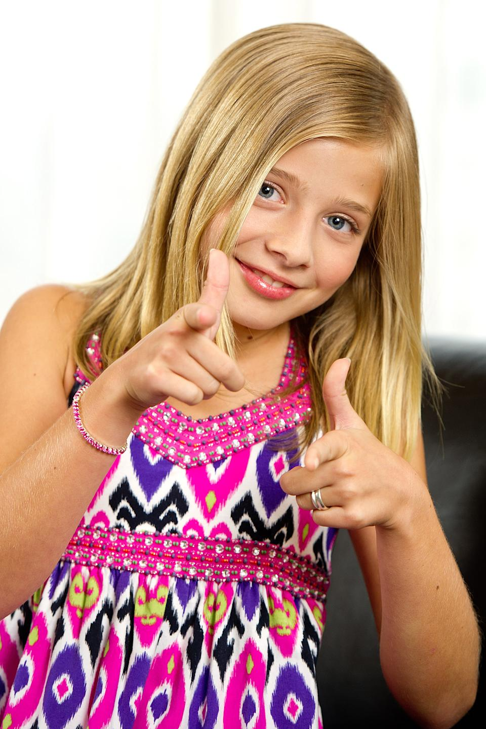 "FILE - In this June 13, 2011 photo, Jackie Evancho, a runner-up on the talent competition series ""America's Got Talent,"" poses for a portrait in New York. Evancho is one of many young singers blazing the charts. (AP Photo/Charles Sykes, file)"