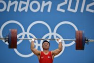 "North Korea's Kim Un-Guk during the men's 62kg weightlifting event at the London Olympics on July 30. North Korea's past and present rulers are inspiring the country's Olympic athletes, according to Pyongyang's official news agency, which reported a ""tumult of joy"" at its strong showing in London"