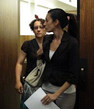 "Jessica Beagley, 36, left, leaves court on Tuesday, Aug. 23, 2011, in Anchorage, Alaska, with an unidentified woman. A jury convicted her of misdemeanor child abuse for squirting hot sauce into the mouth of her adopted Russian son as punishment in what prosecutors said was a ploy to get on the ""Dr. Phil"" TV show. (AP Photo/Mark Thiessen)"