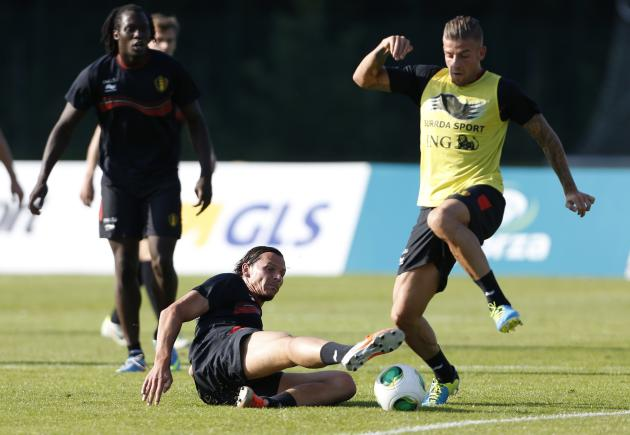 Belgian national soccer team players Van Buyten tackles Alderweireld during a training session in Brussels