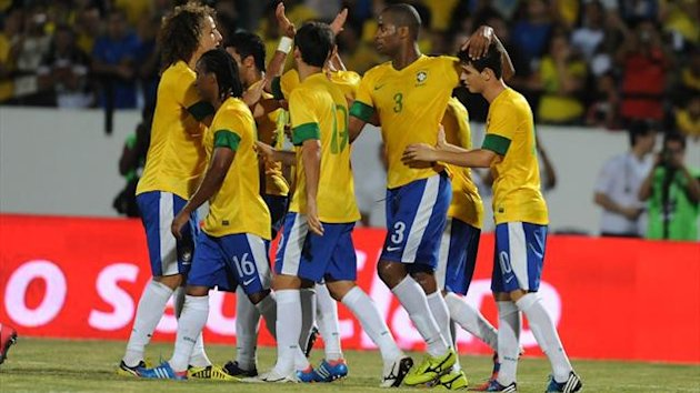 Brazilian players celebrate their 8-0 victory over China following their friendly match at Arruda stadium in Recife (AFP)