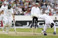 Hashim Amla of South Africa (left) is run out by England's wicketkeeper Matt Prior during the second international Test cricket match between England and South Africa at Headingley Carnegie in Leeds. England claimed three wickets on the first afternoon of the second Test against South Africa at Headingley, fighting back after a wicketless morning and a heavy defeat in the series opener