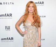 FILE - In this Feb. 6, 2013 file photo, actress Lindsay Lohan attends amfAR&#39;s New York gala at Cipriani Wall Street in New York. Lohan is due back in court on Monday March 18, 2013 for a hearing that will lay out when her trial will begin on misdemeanor charges she lied to police and was driving recklessly when her sports car crashed in June 2012. Lohan&#39;s trial is scheduled to begin this week, but her attorney has previously sought a delay. (Photo by Evan Agostini/Invision/AP, File)