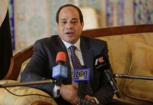 Egypt's President Abdel Fattah al-Sisi answers a question from the media upon his arrival at Algiers airport