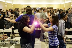 Attendees play a game with each other at the Sunday …