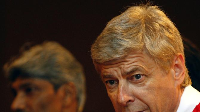 Arsenal manager Arsene Wenger speaks as Malaysian national team coach K. Rajagopal, left, listens during a press conference at a hotel in Kuala Lumpur, Malaysia, Monday, July 11, 2011. Arsenal Football Club will play with the Malaysia XI coached by Rajagopal in their friendly soccer match on Wednesday, July 13. (AP Photo/Lai Seng Sin)