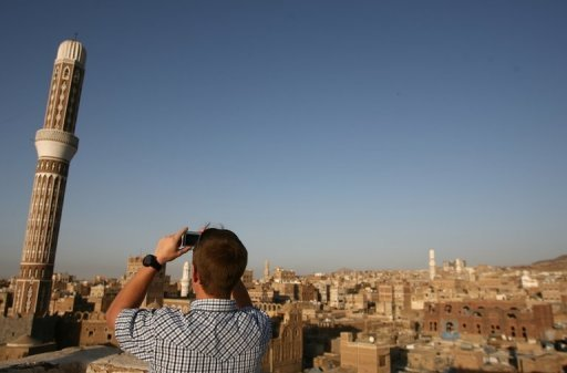 &lt;p&gt;A tourist takes a picture of Sanaa&#39;s Old City on January 15, 2010. Gunmen suspected of links to Al-Qaeda kidnapped two Finns and one Austrian in Yemen&#39;s capital of Sanaa and drove off with them to an unknown location, security officials told AFP.&lt;/p&gt;