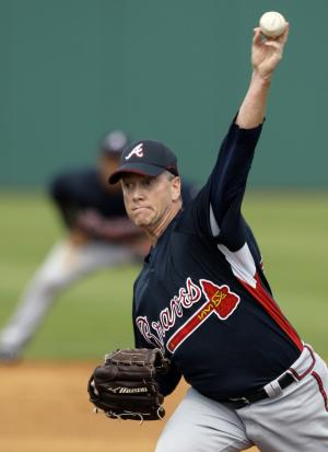 FILE - In this March 1, 2008, file photo, Atlanta Braves pitcher Tom Glavine throws a pitch against the Houston Astros during the second inning of a Grapefruit League spring training baseball game in Kissimmee, Fla. Mad Dog and Glav were fixtures in the Atlanta Braves rotation for years, and now they await word on another possible honor that will keep them together: induction into the Baseball Hall of Fame. (AP Photo/David J. Phillip, File)