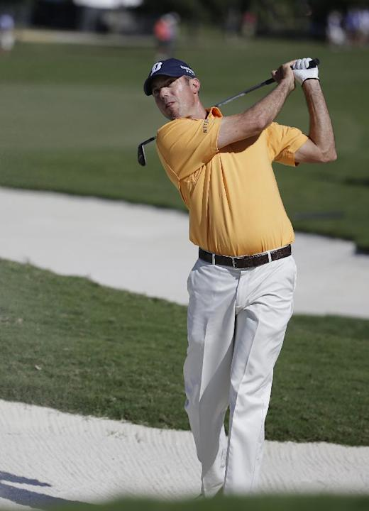 Matt Kuchar hits from a seventh hole bunker during the third round of the Cadillac Championship golf tournament on Saturday, March 8, 2014, in Doral, Fla