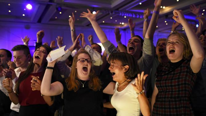 """Supporters from the """"No"""" Campaign react to a declaration in their favour, in Glasgow, Scotland"""