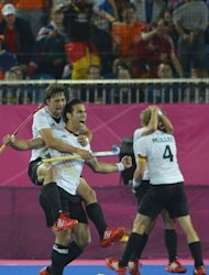 Germany's players react after defeating the Netherlands in the men's field hockey gold medal match at the London 2012 Olympic Games. Germany won gold 2-1