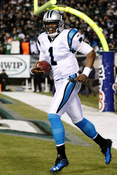Carolina Panthers quarterback Cam Newton celebrates after throwing a touchdown pass in the first half of an NFL football game against the Philadelphia Eagles, Monday, Nov. 26, 2012, in Philadelphia. (