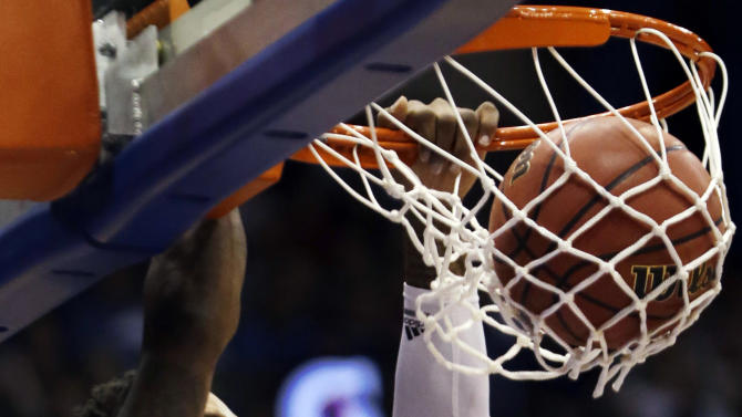Kansas guard Ben McLemore (23) dunks during the first half of an NCAA college basketball game against Richmond in Lawrence, Kan., Tuesday, Dec. 18, 2012. (AP Photo/Orlin Wagner)