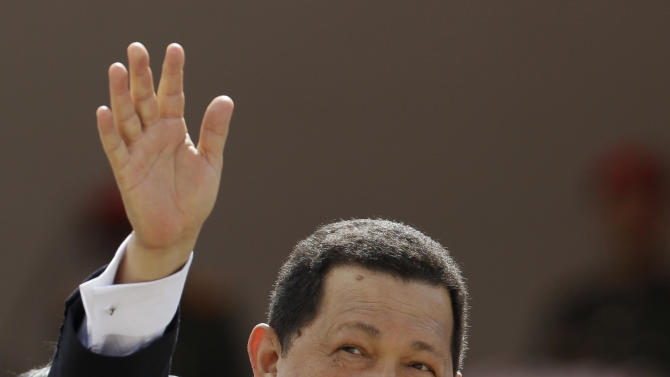 FILE - In this July 5, 2012 file photo, Venezuela's President Hugo Chavez waves during a parade marking Independence Day in Caracas, Venezuela. Chavez is due to be sworn in for a new term on Jan. 10 and his closest allies still aren't saying what they plan to do if the ailing leader is unable to return from a Cuban hospital to take the oath of office. Opposition leaders have argued Chavez, who was re-elected to a six-year term in October, seems no longer fit to continue as president and have demanded that a new election be held within 30 days if he isn't in Caracas on inauguration day. (AP Photo/Ariana Cubillos, File)