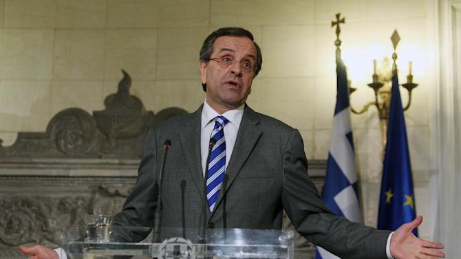 """Greece's Prime Minister Antonis Samaras attends a news conference with his Irish counterpart Enda Kenny, unseen, after their meeting at Maximos Mansion in Athens, Thursday, May 23, 2013. Samaras said that Greece would follow the """"same successful model"""" as Ireland both of the EU presidency and to exit the crisis. Ireland's EU presidency will finish in the end of June. Greece is scheduled to take over the EU's rotating six-month presidency in January 2014. (AP Photo/Thanassis Stavrakis)"""