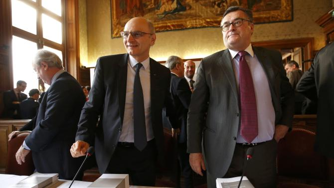 President of the French Court of Accounts Didier Migaud and Rapporteur-General of the French Court of Auditors Henri Paul leave after a news conference in Paris