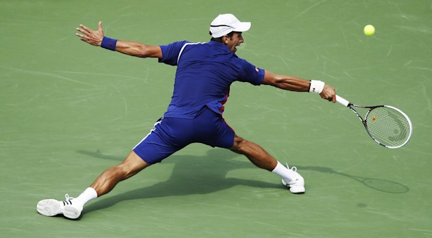 Serbia's Novak Djokovic returns a shot to Julien Benneteau, of France, in the third round of play at the 2012 US Open tennis tournament,  Sunday, Sept. 2, 2012, in New York. (AP Photo/Mel C. Evans)