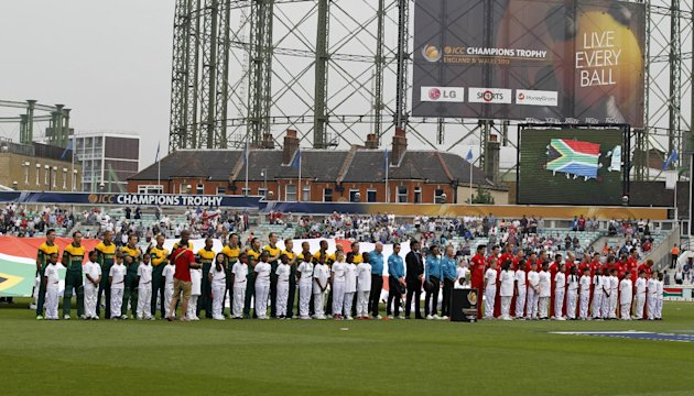 England players, right, and South Africa players line up at the start of their ICC Champions Trophy semifinal cricket match at the Oval cricket ground in London, Wednesday, June 19, 2013