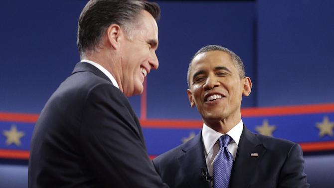 Republican presidential candidate, former Massachusetts Gov. Mitt Romney, left, and President Barack Obama, right, shake hands on stage before the start of their first debate at the University of Denver, Wednesday, Oct. 3, 2012, in Denver. (AP Photo/Pablo Martinez Monsivais)