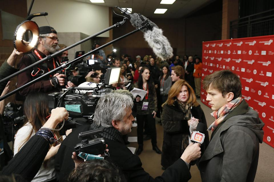 "Actor Ashton Kutcher, right, who portrays Apple's Steve Jobs in the film ""jOBS,"" is interviewed at its premiere during the 2013 Sundance Film Festival on Friday, Jan. 25, 2013 in Park City, Utah. (Photo by Danny Moloshok/Invision/AP)"