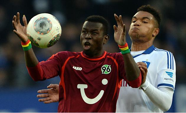 Hamburg's JonathanTah, right,  vies for the ball with Hannover's Mame Diouf during the German Bundesliga soccer match between Hamburger SV and Hannover 96 at Imtech Arena in Hamburg,Germany, Sunday No