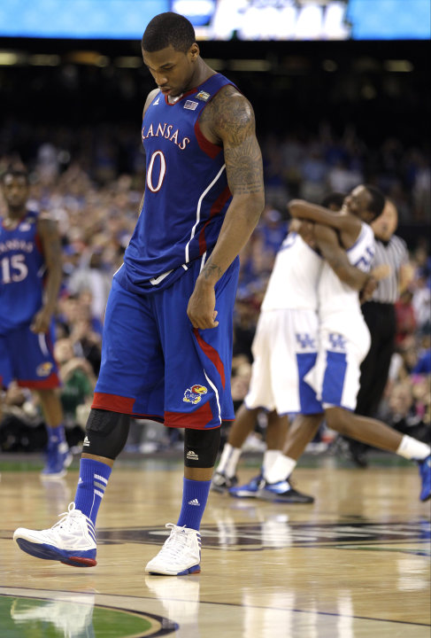 April 2 Kansas forward Thomas Robinson (0)  reacts after the NCAA Final Four tournament college basketball championship game Monday, April 2, 2012, in New Orleans.  Kentucky won 67-59. (AP Photo/Mark 