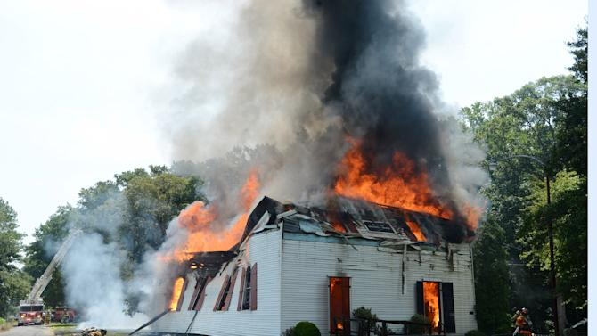 Firefighters from 4 counties and two states battle the fire at St. Pauls Episcopal Church in Hebron, Md., Tuesday, July 22, 2014. The church built in 1773 was on the National Register of Historic Places. (AP Photo/The Daily Times, Todd Dudek) NO SALES
