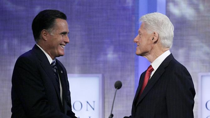 Republican presidential candidate Mitt Romney shakes hands with former President Bill Clinton, Tuesday, Sept. 25, 2012, at the Clinton Global Initiative in New York. (AP Photo/Mark Lennihan)