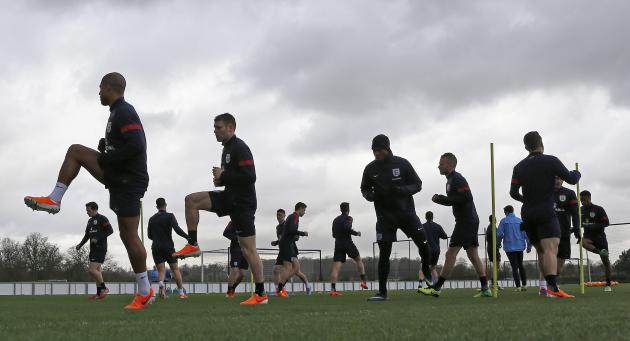 The england players warm up during a team training session at the